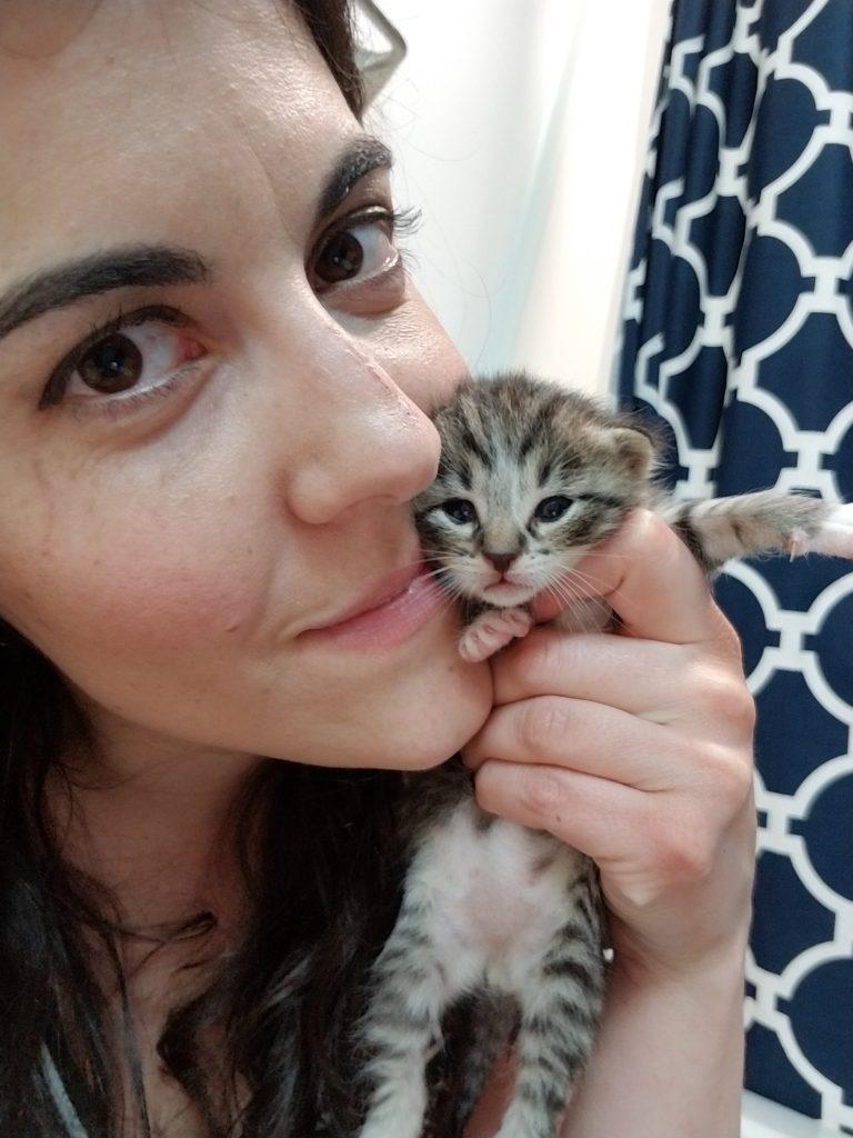 Woman snuggling kitten